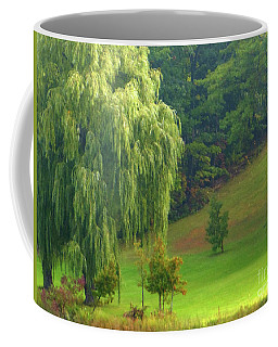 Coffee Mug featuring the photograph Trees Along Hill by Rockin Docks Deluxephotos