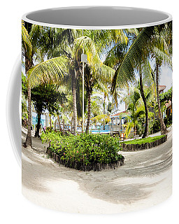 Coffee Mug featuring the photograph Tropical Courtyard by Lawrence Burry