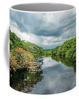 Cloudy Skies Over The River Coffee Mug