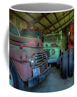 Coffee Mug featuring the photograph Truck Graveyard Warehouse by Jerry Gammon