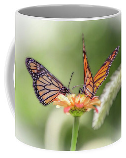 Two Butterflys Working On A Flower. Coffee Mug
