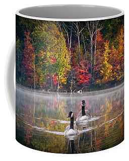 Two Canadian Geese Swimming In Autumn Coffee Mug