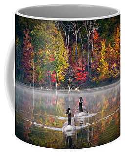 Two Canadian Geese Swimming In Autumn Coffee Mug