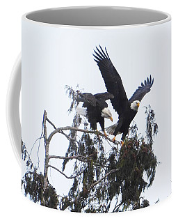 Coffee Mug featuring the photograph Two Eagles Landing In A Tree by Karen Molenaar Terrell