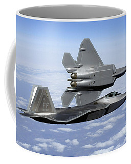Coffee Mug featuring the photograph Two F-22a Raptors In Flight by Stocktrek Images