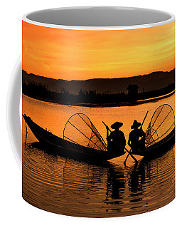 Coffee Mug featuring the photograph Two Fisherman At Sunset by Pradeep Raja Prints
