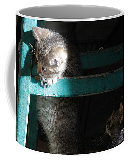 Coffee Mug featuring the photograph Two Kittens With Turquoise Chair by Doris Potter