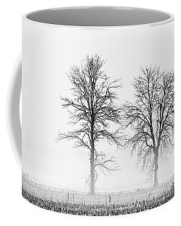 Coffee Mug featuring the photograph Two... by Nina Stavlund