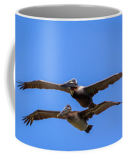 Coffee Mug featuring the photograph Two Pelicans Over The Beach by Randy Bayne