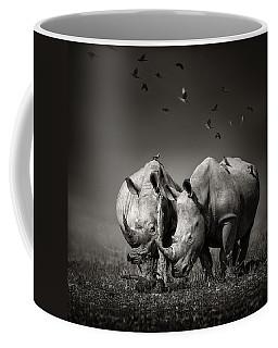 Two Rhinoceros With Birds In Bw Coffee Mug