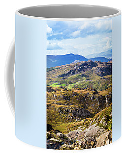 Coffee Mug featuring the photograph Undulating Green, Purple And Yellow Rocky Landscape In  Ireland by Semmick Photo