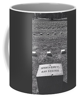Coffee Mug featuring the photograph Unknown Bodies by Robbie Masso