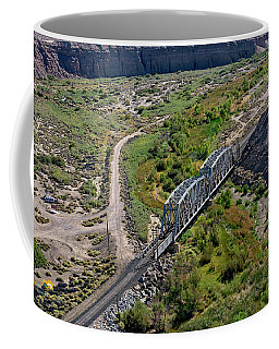 Coffee Mug featuring the photograph Up Tracks Cross The Mojave River by Jim Thompson