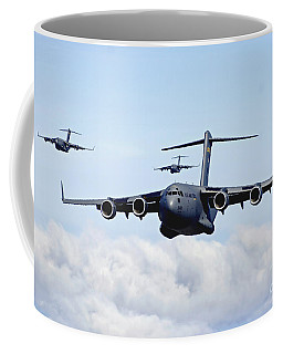 Coffee Mug featuring the photograph U.s. Air Force C-17 Globemasters by Stocktrek Images