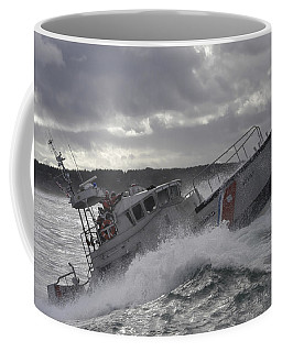 Coffee Mug featuring the photograph U.s. Coast Guard Motor Life Boat Brakes by Stocktrek Images