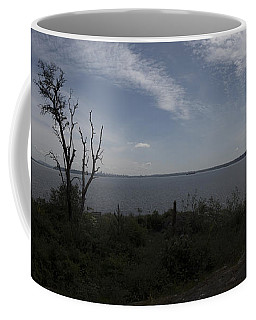Vancouver From Afar Coffee Mug by Rod Wiens