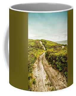 Vibrant Green Hills And Ocean Tracks Coffee Mug