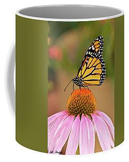 Monarch Butterfly On A Purple Coneflower Coffee Mug by Jeff Goulden