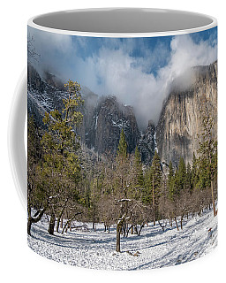 Coffee Mug featuring the photograph View Of El Capitan With Low Clouds On The Peak by PorqueNo Studios