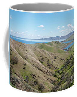Coffee Mug featuring the photograph View Of Water Lake In Between Large Mountains by PorqueNo Studios