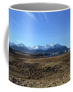Village At The Base Of The Rholyte Mountains In Iceland Coffee Mug by DejaVu Designs