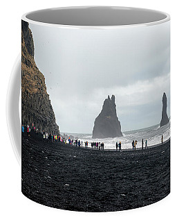 Coffee Mug featuring the photograph Visitors In Reynisfjara Black Sand Beach, Iceland by Dubi Roman
