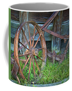 Coffee Mug featuring the photograph Wagon Wheel And Fence by David and Carol Kelly