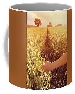 Coffee Mug featuring the photograph Walking Through Wheat Field by Lyn Randle