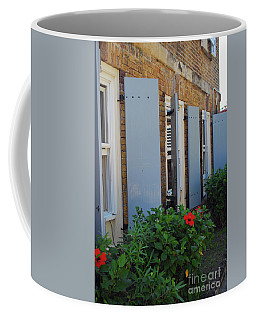 Coffee Mug featuring the photograph Wall Flowers by Gary Wonning