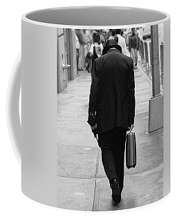 Coffee Mug featuring the photograph Wall Street Man by Dave Beckerman