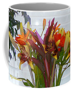 Coffee Mug featuring the photograph Warm Colored Flowers by Elly Potamianos