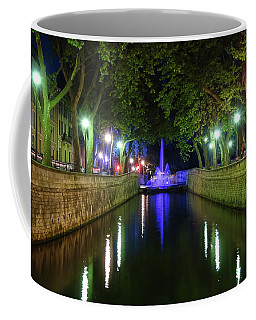 Coffee Mug featuring the photograph Water Fountain At Night by Scott Carruthers