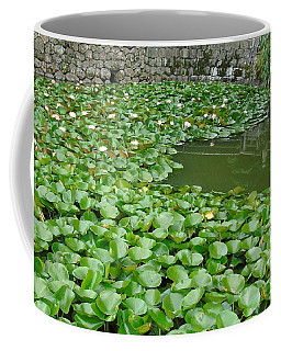 Water Lilies In The Moat Coffee Mug by Susan Lafleur