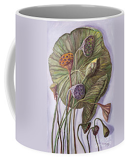 Water Lily Seed Pods Framed By A Leaf Coffee Mug by Randy Burns