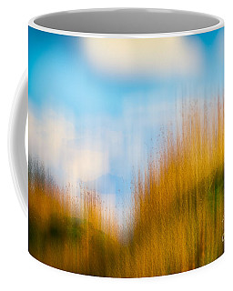 Coffee Mug featuring the photograph Weeds Under A Soft Blue Sky by Nick Biemans