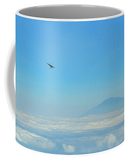 Coffee Mug featuring the photograph White-necked Raven With Twig Soaring Over Mount Meru by Jeff at JSJ Photography