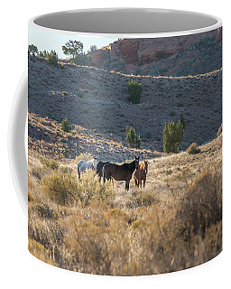 Coffee Mug featuring the photograph Wild Horses In Monument Valley by Jon Glaser
