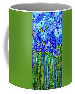 Coffee Mug featuring the mixed media Wild Poppy Garden - Blue by Carol Cavalaris