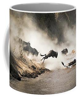 Wildebeest Leap Of Faith Into The Mara River Coffee Mug