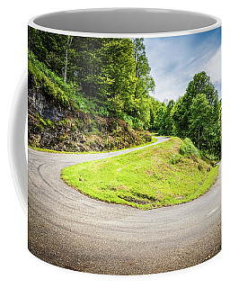 Coffee Mug featuring the photograph Winding Road With Sharp Curve Going Up The Mountain by Semmick Photo