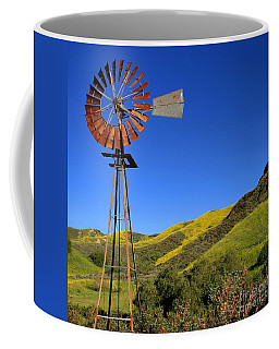 Coffee Mug featuring the photograph Windmill by Henrik Lehnerer
