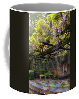 Wisteria Flowers Blooming On Trellis Over Water Fountain Coffee Mug