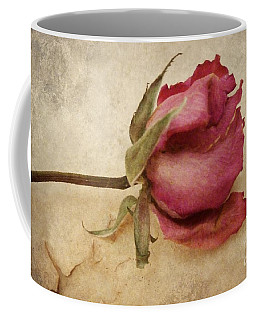 Coffee Mug featuring the photograph Withering Beauty by Patricia Strand