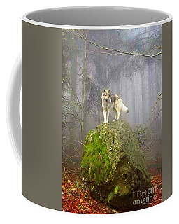 Coffee Mug featuring the photograph Wolf by Susan Carella