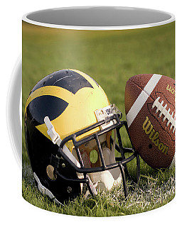 Wolverine Helmet With Football On The Field Coffee Mug