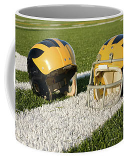 Wolverine Helmets From Different Eras On The Field Coffee Mug