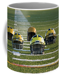 Wolverine Helmets Throughout History On The Field Coffee Mug