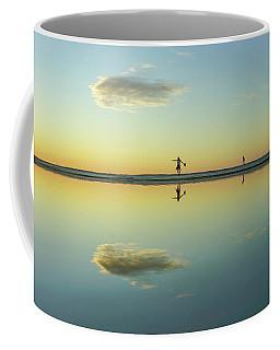 Woman And Cloud Reflected On Beach Lagoon At Sunset Coffee Mug