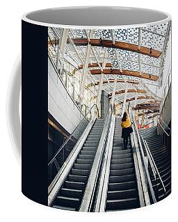 Woman Going Up Escalator In Milan, Italy Coffee Mug