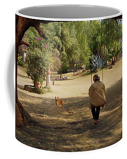 Coffee Mug featuring the photograph Woman On The Swing by John Kolenberg